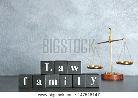 Wooden cubes and law scales on a table