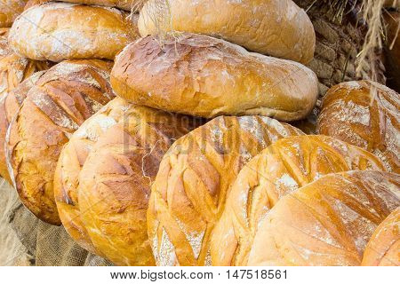 Freshly Baked Traditional Loaves Of Rye Bread On Stall