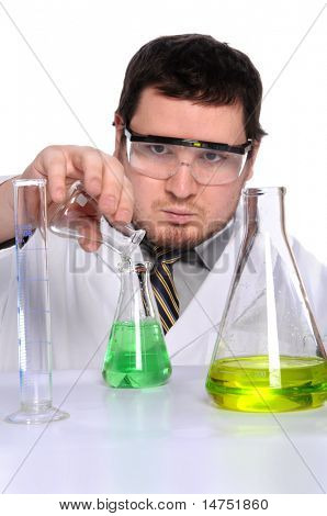 Scientist working in laboratory pouring liquid into flask