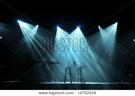 Stage with bright lights and microphones ready for concert