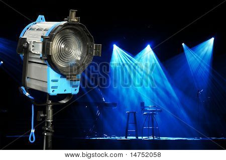 Incandescent light and stage with bright lights and microphones ready for concert
