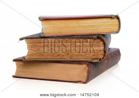 Old books in a pile isolated over white background
