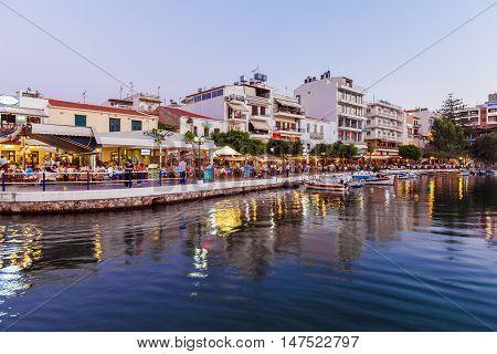 Agios Nikolaos, Greece - July 24, 2012: Tourists Eating In Restaurants Near Voulismeni Lake