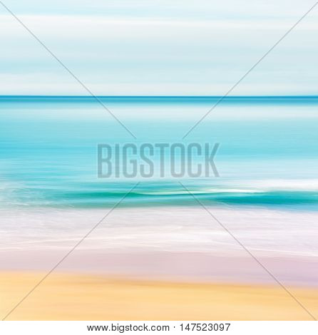 A seascape in a tropical setting with a calm turquoise ocean. Image made with motion blur and a long exposure.