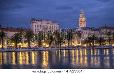 Nighttime view on Riva waterfront, houses and Cathedral of Saint Domnius, Dujam, Duje, bell tower in old town, Split, Croatia, HDR