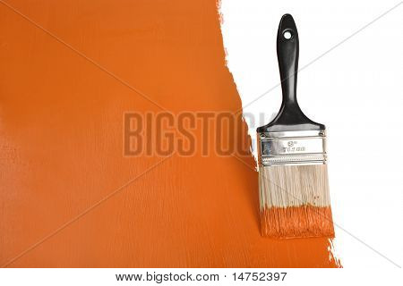 Brush painting wall with orange paint