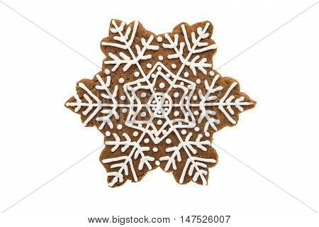 Gingerbread snowflake cookies decorated with white icing