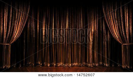 Stage golden curtains over wooden floor