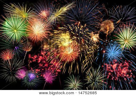 Fireworks of different colors brighten the night sky