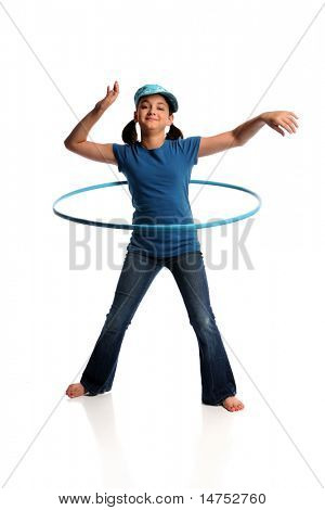 Young girl playing with hula hoop isolated over white background