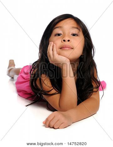 Portrait of young Asian girl laying on floor isolated over white background