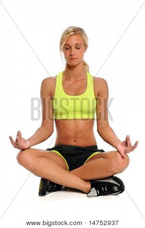 Beautiful young woman practicing yoga isolated over white background