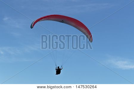 Blue Sky, Parachute And Human Silhouette. Adventure
