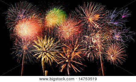 Bright and colorful fireworks against a black night sky