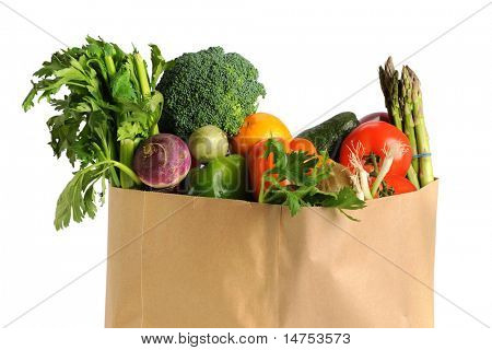 Paper grocery bag with fruits and vegetables isolated over white background