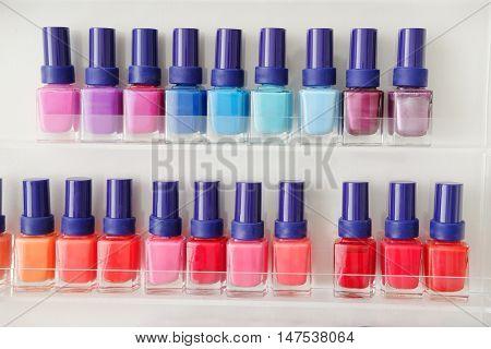 Close up of colorful nail polish bottles