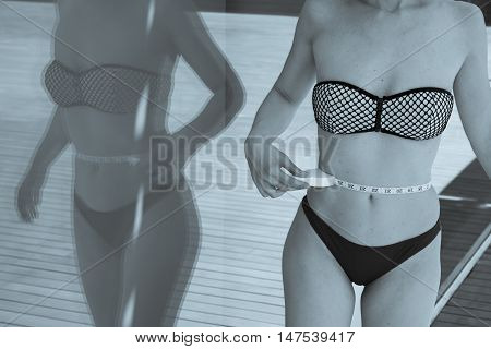Part of the body of a woman measuring contour and body fat