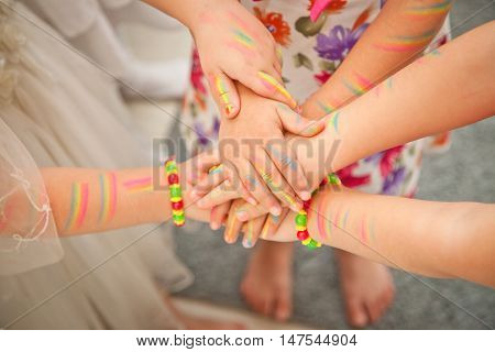 United children's hands closeup. the painted paint