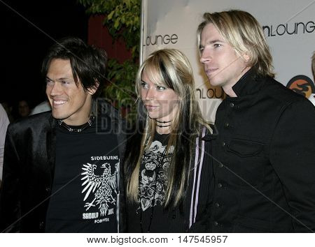 Rock Star: INXS cast members Mig, Suzie and Marty at the Burn Lounge Launch Party held at the Cabana Club in Hollywood, USA on September 10, 2005.