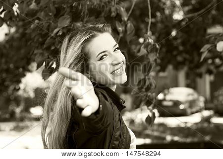Young smiling girl waving to someone - that hand.