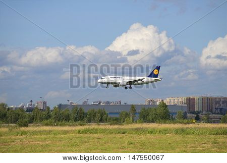 SAINT PETERSBURG, RUSSIA - JULY 24, 2015: The Airbus A319 (D-AILN) the company Lufthansa is landing in Pulkovo airport