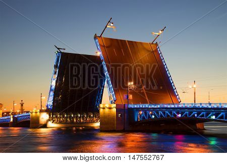 SAINT PETERSBURG, RUSSIA - JULY 06, 2015: Divorced Palace bridge on a summer night closeup. Historical landmark of the city Saint Petersburg