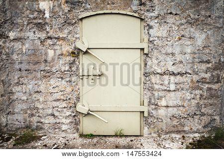 Locked Massive Metal Door In Old Wall