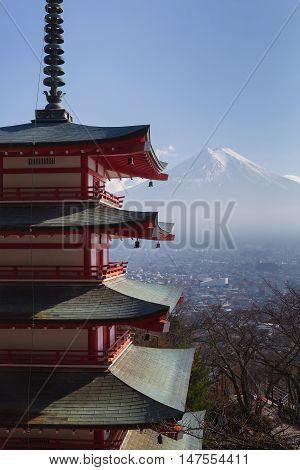 Fuji volcano mountain behind red pagoda, Japan