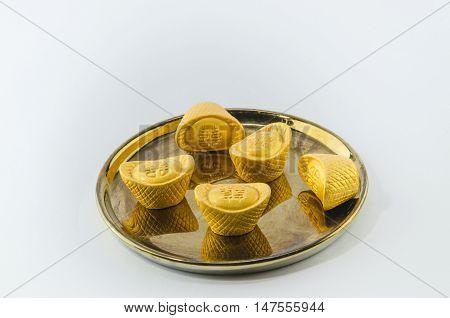 Gold ingot on golden plates white background