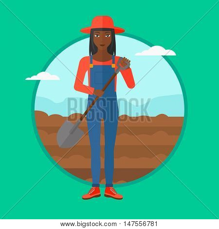 An african-american woman working on a field with a shovel. Female farmer standing with shovel on the background of plowed field. Vector flat design illustration in the circle isolated on background.