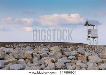 Lifeguard stand on the hill with blue sky background