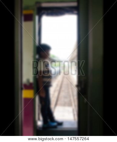 blurry abstract of the little boy standing alone at inner train