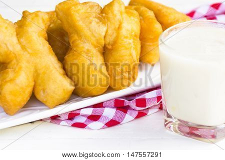 Bread stick or chiness deep fried  or patongko of thai and soy milk .Meal or breakfast of thailand and asia.Close up