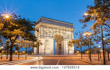 The Triumphal Arch at night Paris France.