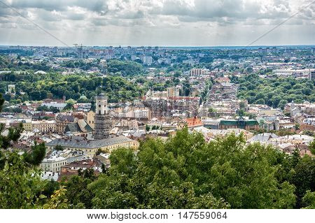 Lviv Ukraine old city vintage toned top view panorama with houses roofs. Sity hall tower tower