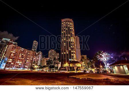 Honolulu Oahu Hawaii - August 19 2016: friday night fireworks at Hilton Hawaiian Village luxurious resort overlooking Waikiki Beach near Ala Wai Harbor.