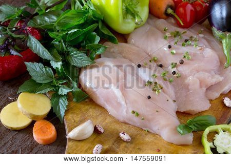 Fresh Raw Chicken With Vegetables On A Cutting Board.