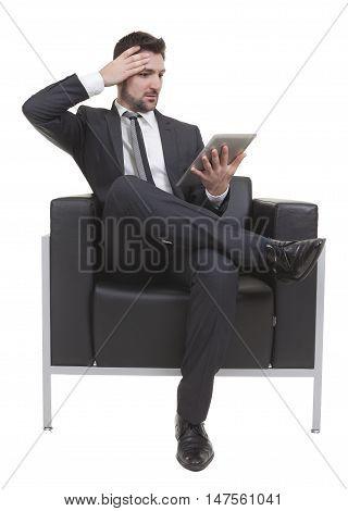 Businessman Sitting Looking Tablet