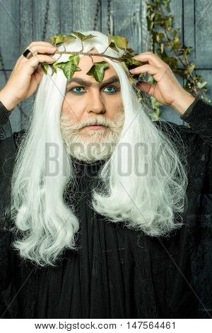 Zeus god man or jupiter with vine crown on long hair with beard