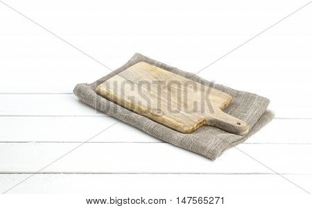Empty vintage cutting board on planks food background concept