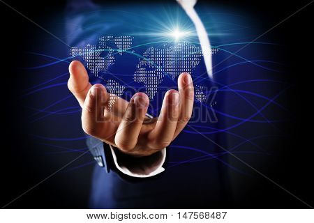 Businessman holding digital world map in hand. World map and binary code on digital display. Technology concept.