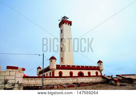 Low angle with of the Lighthouse Monumental La Serena with a sunny blue sky at the beach of La Serena in Chile, South America