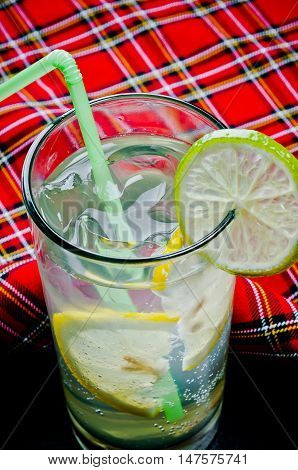 summer cool refreshing lemonade with ice cubes and lemon on a bright background for the menu in restaurants clubs bars cafes