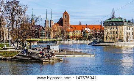 WROCLAW, POLAND - MARCH 19, 2016:Overall view on Sand Island (Wyspa Piasek) on the Oder River in Wroclaw, Poland. In the center the Church of the Blessed Virgin Mary.