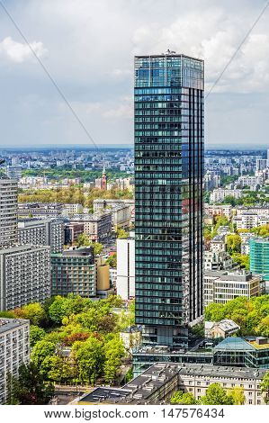 WARSAW, POLAND - MAY 3, 2016: The Cosmopolitan Tower a mainly residential skyscraper at 160 m high with 44 storeys includes 252 apartments with a net total area of above-ground floors of 32000 sqm.