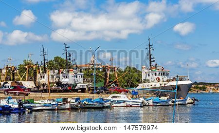 SOZOPOL, BULGARIA - JULY 16, 2016: Cutters moored in the port of Sozopol, one of the oldest Bulgarian towns founded in the 7th century BC, nowadays one of the major seaside resorts in the country.