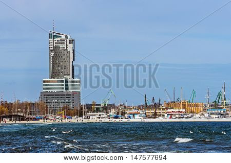 GDYNIA, POLAND - APRIL 10, 2016: The Sea Towers multi-use skyscraper. Built in 2009 building is the 10th tallest building in Poland and the second tallest residential building in the country.
