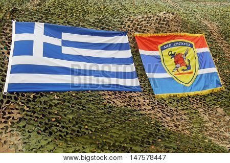 Greek national flag and greek army military flag with message Aien Aristeyein. Aien Aristeyein means always be the best. Ippolachos said that to his son Glaykos before the battle of Troy.
