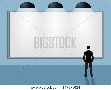 Man in suit looking at blank billboard