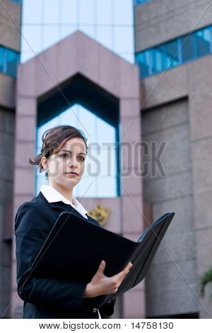 young confident beautiful businesswoman holding a file folder